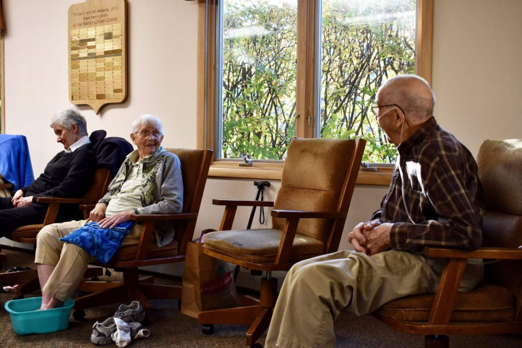 elderly patients talking with one another